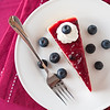 Cheesecake dessert with blueberries fruit on the side. Focus on the top of the cake.