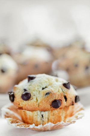 delicious homemade muffins with chocolate chips on it. Selective sepia tone and very shallow depth of field.