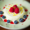 Ice-cream cake summer dessert with fresh fruit around. Extremely shallow depth of field and added vignetting.