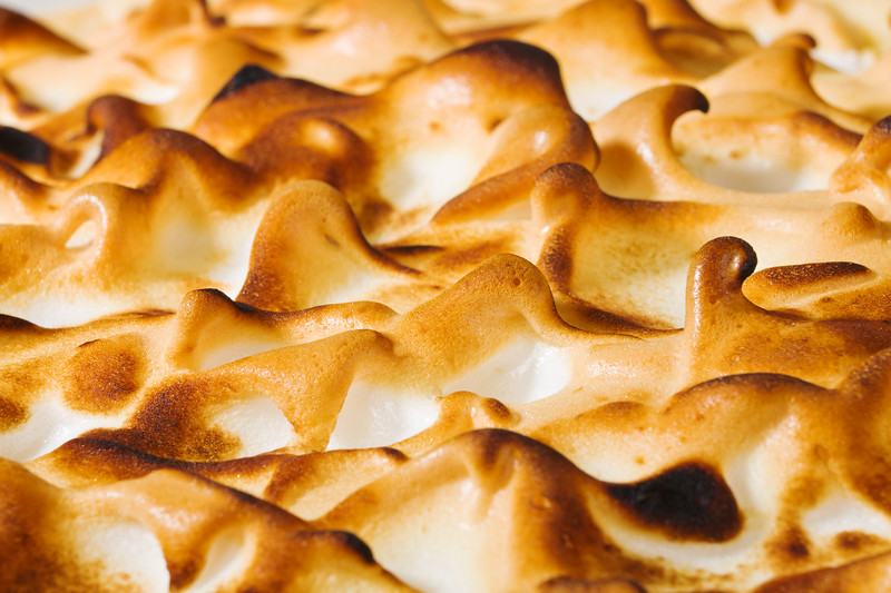 Macro photography from meringue on the top of a citrus pie dessert. Very shallow depth of field.