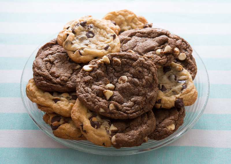 Homemade chocolate chips cookies on a plate with a white and blue background. Sweet food.