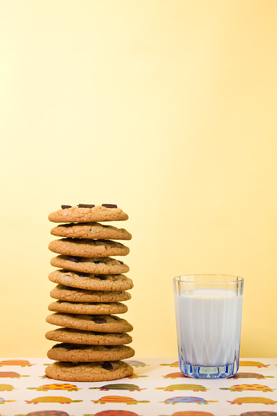 Butter cookie stacked with chocolate chip and milk on the side. Empty space to add your text. Very Shallow depth of field.