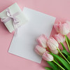 A Bouquet Of Tulips, A Gift Card On A Pink Background. Gift. A Box With A Gift. International Women'