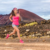Trail run ultra runner sport woman running training cardio on rocky mountain path on long distance e