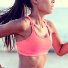 Cardio running workout - Upper body closeup crop of unrecognizable woman runner in fast motion showi