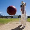 Full length of batsman playing cricket on pitch against blue sky during sunny day
