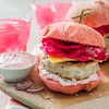 Pink chicken grill burger on wood background, copy space