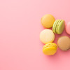 Tasty sweet macarons. Macaroons on pink background. Top view.