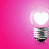 Heart Glow Inner Electric Lamp On Pink Background.