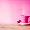 pink Coffee cup mug with red heart shape on wooden table Romance and love valentines day on pink background concept