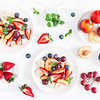 Fruit Salad With Strawberry, Blueberry, Peach, Banana, Grape And Fresh Fruits On White Background. F