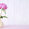 Bouquet Of Peony Flowers In Vase On Pink Wooden Table