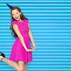 people, holidays and celebration concept - happy young woman or teen girl in pink dress and party ca