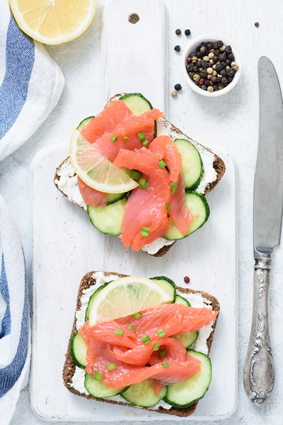 Smoked Salmon, Cream Cheese And Cucumber Toast Sandwiches On White. Top View