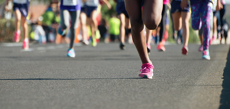 Running children, young athletes run in a kids run race