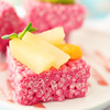 Pink crispy dessert with fruits and mint leaf
