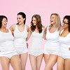 friendship, beauty, body positive and people concept - group of happy women different in white under