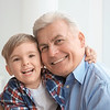 Portrait of happy senior man with grandson