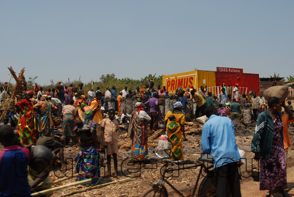 People gathering by the side of the road near Rutana, Burundi, in order to collect food or goods