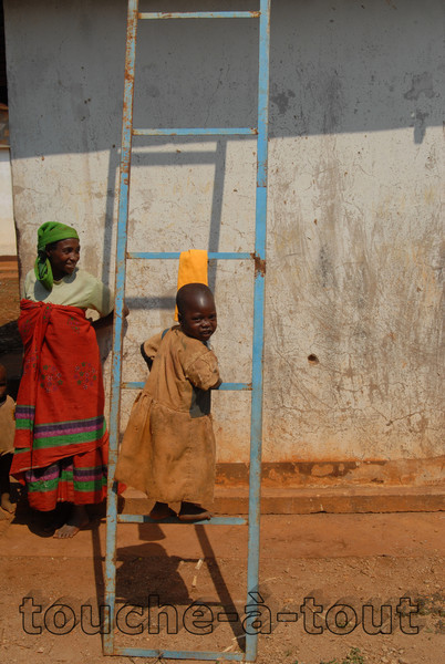 A child plays on a ladder outside a rural hospital, near Rutana, Burundi
