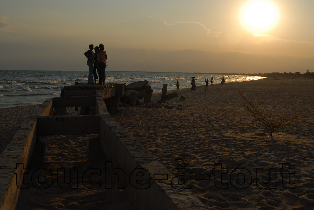 Lookoing out over Lake Tanganyika from a ruined pier on the beach at Bujumbura, Burundi