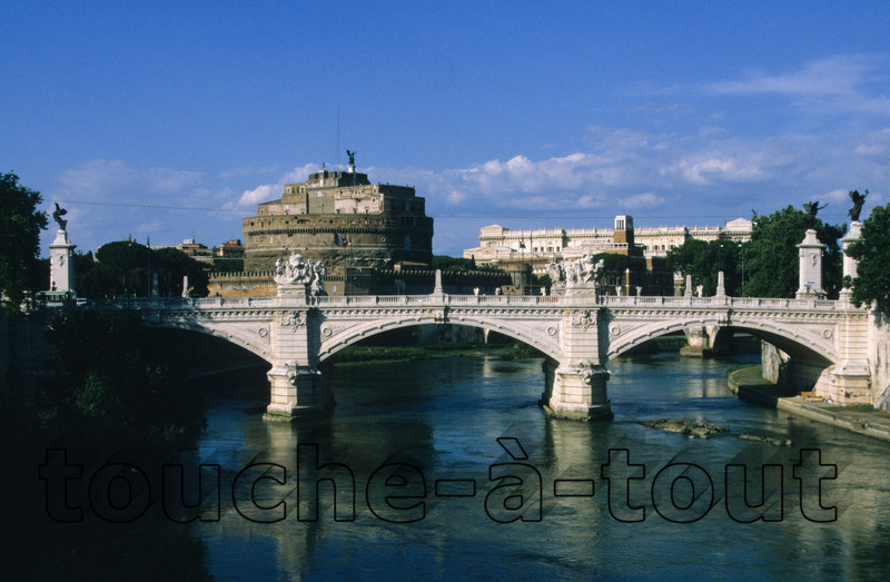 Ponte Vittorio Emanuele II and Castel Sant' Angelo from the banks of the river Tevere<br /> Ponte Vittorio Emanuele II and Castel Sant' Angelo from the banks of the river Tevere