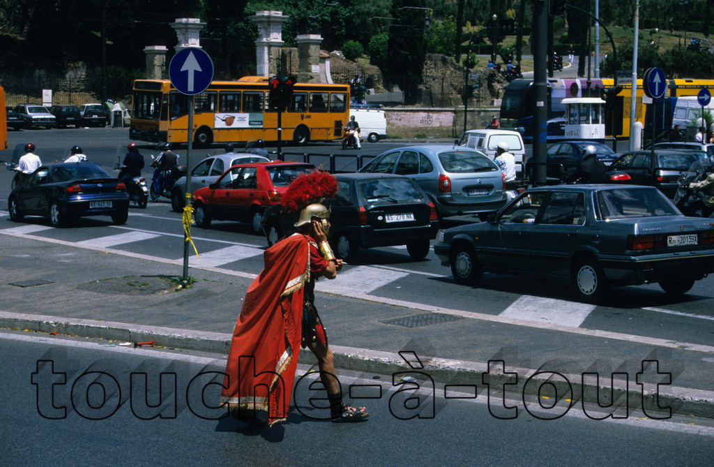 Centurion makes a phone call<br /> A Roman Centurion takes time out to make a mobile phone call near the Colosseum