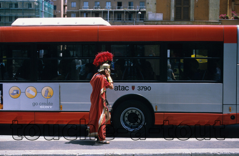 Centurion time-warp<br /> A Roman Centurion takes time out to make a mobile phone call near the Colosseum