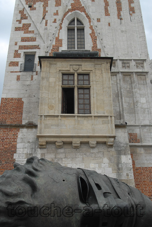 Statue below tower in Krakow main square