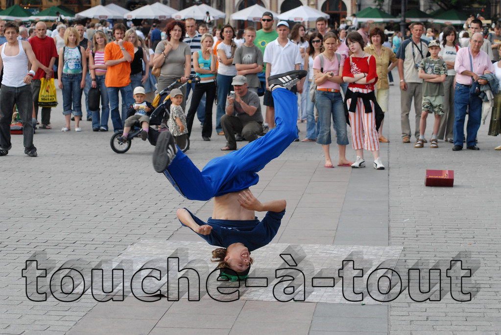 Break dancer in main square, Krakow, Poland