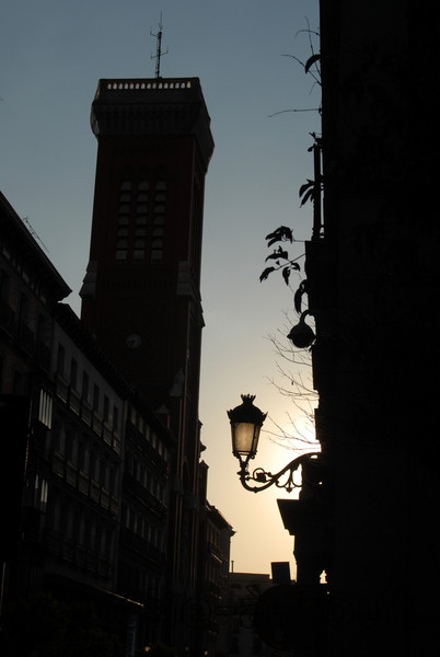 Silhouette of lamp and tower in Madrid, Spain