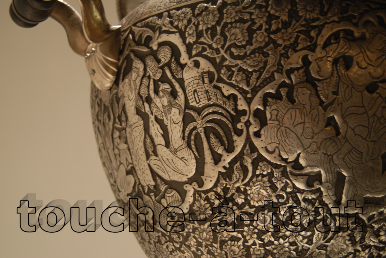 Detail of highly decorated metal bowl, Mirai Islamic Art Centre, Dubai