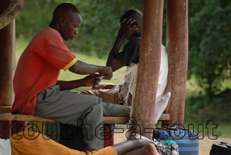 A fisherman mends his nets by the Nile, Murchison Falls National Park, Uganda