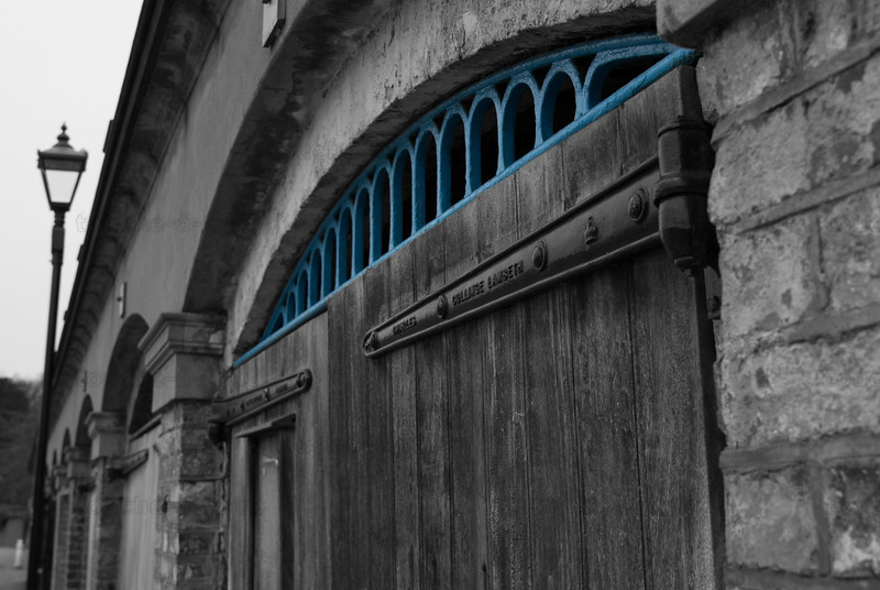 The doors of old boathouses by the Thames in Richmond