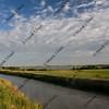 irrigation channel and Colorado farmland