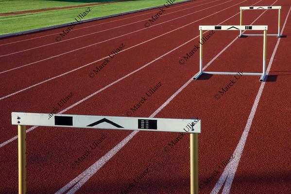 running tracks with three hurdles