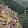 straw cowboy hat on sandstone rocks