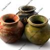 three rough clay plant pots