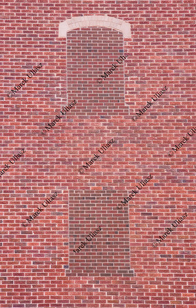 brick wall with two blind windows