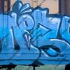 blue graffiti on a train