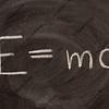 Albert Einstein E=mc2 physical formula on blackboard