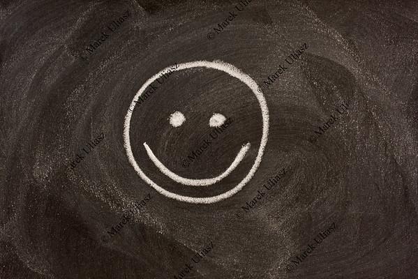 smile sign on blackboard