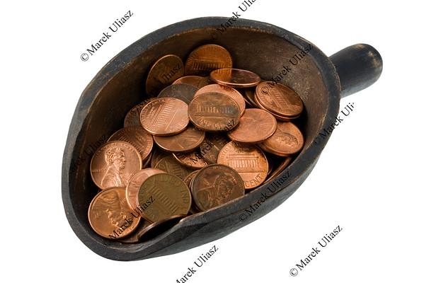 scoop of pennies - money concept