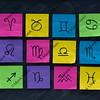 western zodiac symbols on sticky notes and blackboard