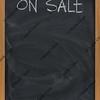sale advertisement on blackboard in vertical