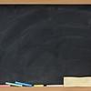 blank blackboard with eraser smudges