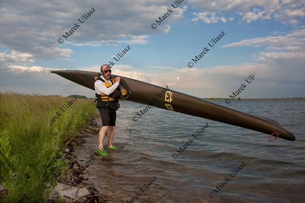 mature paddler and racing kayak