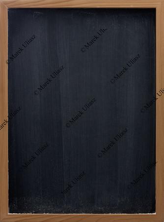 blank blackboard with vertical eraser smudges