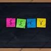 symbols of four currencies on blackboard