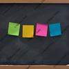 blank, colorful sticky notes on blackboard